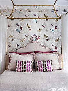 """Don't limit your design prowess to traditional """"kid"""" wallpaper prints. Go PG-13, with more a mature paper, and accent with delicate, whimsical pieces to give it a younger feel."""