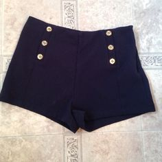 Navy sailor style high waisted shorts Really cute high waisted sailor shorts. Never worn, just took the tags off! They are really adorable just too big for me! Forever 21 Shorts