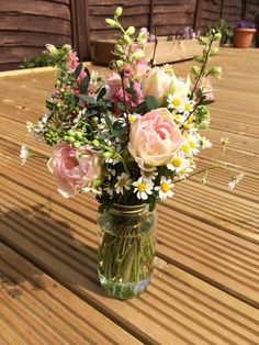 Early summer, late spring jam jar flowers. Tulips, delphiniums and daisies…