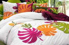 Tropical Breeze's design is fresh with a bit of village charm thrown in. The large and colorful appliqués with audacious embroidered frond and floral motives in juicy and breezy colors of lime, papaya, pineapple, guava and dragon fruit are the embodiment of beachy glamour!    Consists of 100% cotton with 100% polyester appliqués, 220 thread count, embroidery and appliqué.