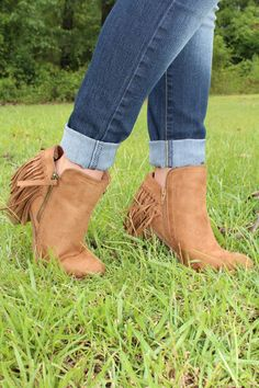 Buffy Bootie - Chestnut $38 The must have booties for fall are here! These fabulous fringe booties will be sure to add the finishing touch on your fall outfits. One touch on their soft vegan suede and you'll understand what all the fuss is about!