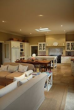 I like the layout of this kitchen, the dining table breaking up the space between the living area and the kitchen