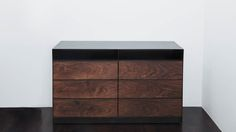 Shown in claro walnut and hand-blackened steel, 60 x 20 x 36H DESCRIPTION The Franklin Dresser features six spacious drawers and ample top stowage in a compact frame. Custom pulls chart an elegant course along the dresser's face. Featuring highly marbled claro walnut panels and a slick hand-blackened carcass, the Franklin Dresser is both practical …