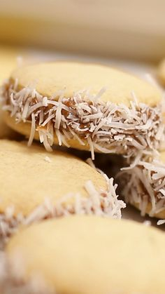 Recipe with video instructions: Alfajor Cookies recipe Ingredients: 7 oz flour, 10 ½ oz Corn starch,  2 teaspoons baking powder, ½ teaspoon baking soda, 7 oz butter, 5 ⅓ oz sugar, 3 egg yolks, Zest of 1 lemon, 1 teaspoon vanilla extract, 2 cups dulce de leche, 7 oz grated coconut