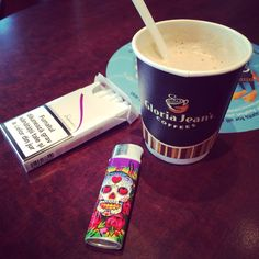 Gloria's Jeans Coffee Shop | sobranie superslims white ciggaretes | waiting for my flight from Bucharest to Paris |