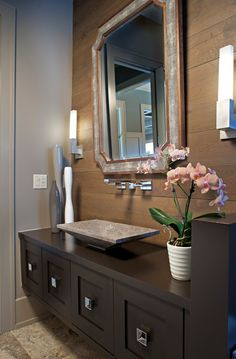 Transitional Powder Room with Vessel sink, Slate counters, complex granite tile floors, Flush, Flat panel cabinets