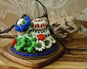 Felt and zipper pincushion  in  embroidery hoop. $34.00, via Etsy.