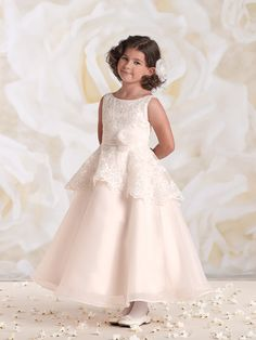 Sleeveless satin, organza, tulle and lace tea-length A-line dress with bateau neckline, scalloped lace overlay peplum bodice features a ruched organza waistband with side three-dimensional flower, covered buttons down back, full double layer organza overlay skirt with horsehair hem, perfect as a flower girl dress or First Holy Communion dress. Sizes: 2 – 14 Colors: …