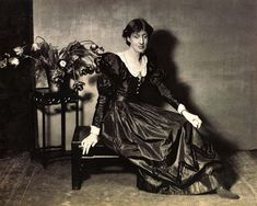 Virginia Woolf in 1924, posing for Vogue in a dress of her mother's.