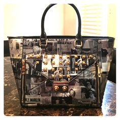 Marilyn Monroe tote If you like Marilyn Monroe then you'll love this awesome tote. Patent leather silver , black, with gold studs, and spacious!! (New) never used Bags Totes