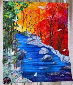 Beautiful landscape quilt.