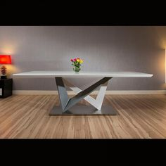 Large rectangular modern dining table white glass 220 x 110cm. High quality large rectangular dining table With white glass top superb quality with high specification super-white glass glass top and white/grey gloss central pedestal. Call 02476 642139 or email sales@quatropi.com for additional information.