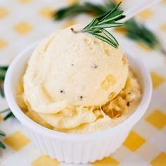 Homemade pineapple gelato with fresh rosemary