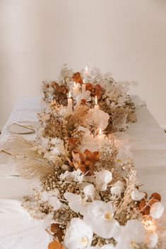 We wanted to create a table centerpiece with dried and fresh flower that had an Autumn wedding feel to it without going overboard on the darker tones--maintaining the lightness we love about weddings. Photos by Lara Onac. Dried Flower Arrangements, Flower Centerpieces, Flower Decorations, Dried Flowers, Wedding Centerpieces, Autumn Wedding Decorations, Floral Wedding, Fall Wedding, Wedding Colors