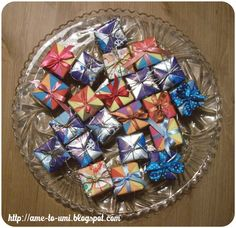 Sonobe cubes. Each made of 6 sonobe units. Sonobe unit is credited to Mitsunobu Sonobe.