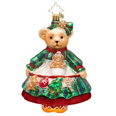 This collectible glass Christmas ornament features a Muffy VanderBear teddy bear who is dressed up in the most adorable baby chick costume with an orange bow to tie it all up. Description from radko-christmas.com. I searched for this on bing.com/images