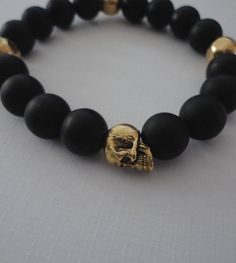 Black Onyx Double Skull Bracelet for Men with Brass Accents