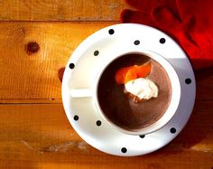 If you've got a snow storm headed your way, then it's probably time to start making some hot cocoa. My version is just slightly amped up to enhance the chocolate to its fullest, by adding some toasted cinnamon, ginger-spiked whipped cream and a fresh twist of orange peel.   #Snowday #jonas #Recipe #Chocolate