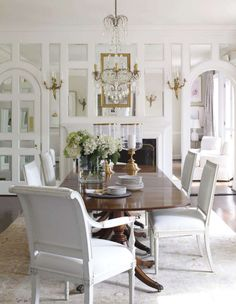 Suellen Gregory creates a stunning dining room in a Richmond, Virginia home. I'm smitten with the mirrored and paneled wall.