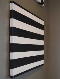 DIY duct tape art! Maybe in a chevron pattern for the living room?