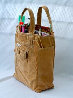 Old jeans recycled as a knitting bag Ill figure out a way to re-create it!
