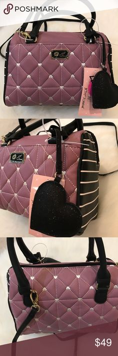 """NWT Betsey Johnson mauve heart crossbody Pretty Betsey Johnson mauve heart crossbody. Approximately 9""""W x 7""""H. Magnetic closure pocket in front. Spacious interior. Detachable crossbody strap. Can be carried as a small barrel bag. No Trades. Perfect 5 ⭐️ rating and over 700+ items sold. Betsey Johnson Bags Crossbody Bags"""