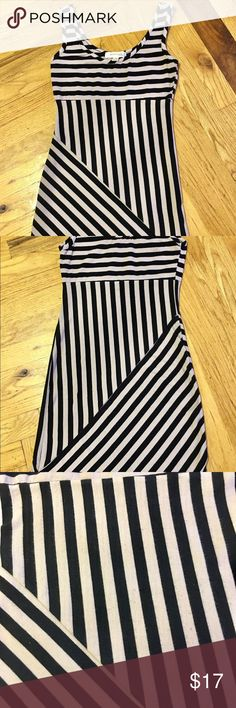 """Black and Tan striped dress Adorable black & light tan asymmetrical striped mini dress. Sized small but could fit an XS. Really great for summer or add a moto jacket and booties for an edgy fall look! Approximate measurements lying flat: Armpit to armpit- 14.25""""  Waist- 12.5""""  Shoulder to bottom hem- 31.25"""" Monteau Los Angeles Dresses Mini #summerdressesmini"""