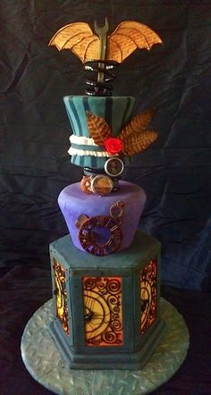 Ok, coolest cake ever.  I tried to find a picture from the actual bakery's website (www.goodgraciouscakes.com) but couldn't find it in their gallery.  This post has a link, though!