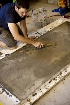 build a concrete table top...they do this for a dining table but I'd like to see it as a coffee table!