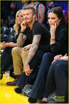 David Beckham And His Wife Victoria Share A Sweet Moment While Attending The Lakers Game On Tuesday May At Staples Center In Downtown Los Angeles