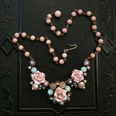 Turquoise & pink bead necklace. Etsy. I am a sucker for any sort of floral on a black background...
