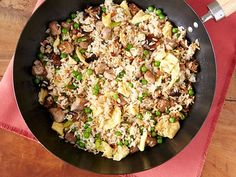 Fried Rice : Comfort food doesn't always have to be about cheesy, creamy sauces. This fried rice recipe from Food Network Kitchen combines tender cubes of meat with egg and veggies that are cooked in peanut oil for a result that is satisfying and savory.
