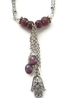 Ruby and Sterling necklace with sterling hamsa and Star Rubies i love hamsa. do you have any w/ evil eyes as well?