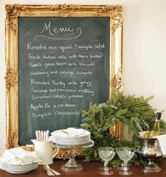 A gilded-frame chalkboard makes an elegant touch in a holiday dining room. DIY with gold leaf and chalkboard paint.