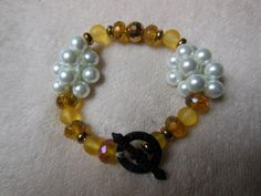 Yellow Bead and White Pearl Bracelet with Black Arrow Clasp by handmadejewelrybypam on Etsy