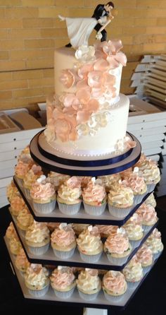"""Wedding Cupcake Tower, Every guest can have their own cupcake. I love the pose of the bride and groom in a full dance """"dip""""."""