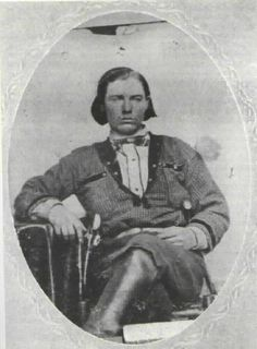 This photo of Frank James was probably taken shortly after he joined the Confederate Guerrillas led by William C. Quantrill. It was likely taken in the summer of 1863. Note the holstered pistols.