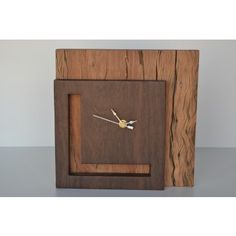 This clock is hand-made by skilled South African Artisans, with no added stains or treatments, making them 100% biodegradable. The back panel is crafted from reclaimed Ironwood railway sleepers, which gives the clock texture and character from the natural weathering that has occurred due to its exposure to the elements over many years. A recycled Leadwood cut out is used on the face of the clock to complement the excellent quality time pieces.