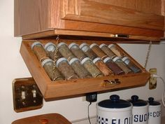 Out of the way but easy access Spice Rack idea! This would be great for a Tiny House!