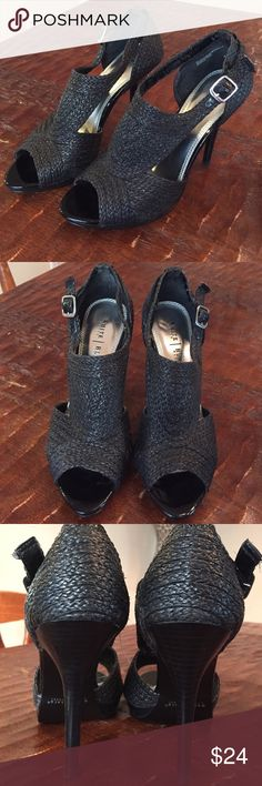 Braided straw shoes Braided synthetic straw toeless high heels. Strap and buckle. Gently used condition. Any wear is mainly just seen in the buckles. Still shiny and unknicked for the most part. 4 1/2 inch heels White House Black Market Shoes Heels