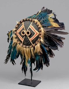 Africa | 'Gitenga' (Muyombo) face mask from the Pende people of DR Congo | Basketry, feathers, pigment and natural fiber
