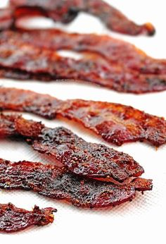 This super easy Grilled (or baked) Candied Bacon is delicious all by itself, but it also makes a great topping for baked potatoes, salad, or chili.