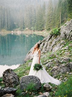 Have you picked your jaw up off of the ground yet? I mean the landscapes in this shoot by DARYA KAMALOVA in the Italian Dolomites are nothing short of mind-blowingly spectacular! Featuring a deep v-neck gown from PRONOVIAS and a cathedral length veil by S