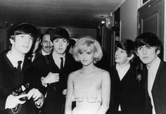 18th January 1964: The British pop band The Beatles, left to right, John Lennon (1940 - 1980), Paul McCartney, Ringo Starr and George Harrison (1943 - 2001), after their Paris show, with their co-star the French singer Sylvie Vartan. (Photo by Keystone/Getty Images)