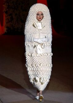 A white knitted cocoon makes the model look like a doll. Photo: A wedding dress designed in 1965 and showcased at Yves Saint Laurent's retrospective fashion show in Wedding Dress Fails, Worst Wedding Dress, Ugly Wedding Dress, Crochet Wedding Dresses, Horrible Wedding Dress, Funny Wedding Dresses, Tacky Wedding, Funny Weddings, Crazy Wedding