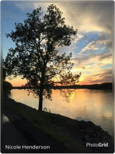 Sunset over Tennessee River at Florence, Alabama 8/2/15.  Photographer credit: Nicole Henderson.  PhotoGrid used to add photographer's name to photo.
