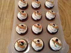 Chocolate cupcakes with ice-white vanilla frosting and royal icing hockey stick & puck