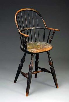 """PENNSYLVANIA CHILD'S BOWBACK WINDSOR HIGH CHAIR IN OLD SURFACE, LATE EIGHTEENTH CENTURY. The bowed back over seven spindles flanked by shaped arms over a shaped seat raised on vase and ring-turned splayed legs joined by an H-stretcher.    Literature: For a similar example, see Albert Sack's """"Fine Points of Furniture, Early American"""" p. 86. Sold at Northeast Auctions August 3-5, 2012."""