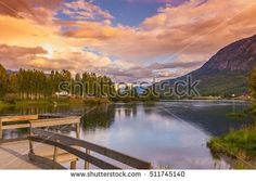 Beautiful mountain lake dawn, Norway, Scandinavia. Amazing beautiful lake nature background, wallpaper. Norwegian mountain lake landscape with beautiful dawn clouds. Norway, north Europe dawn nature.