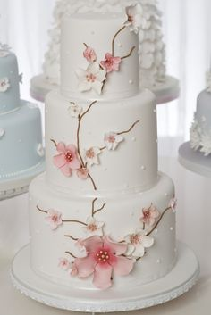 Japanese Blossom  £565    A delicate, oriental inspired blossom cake decorated with pretty flowers in muted hues with gold detail.